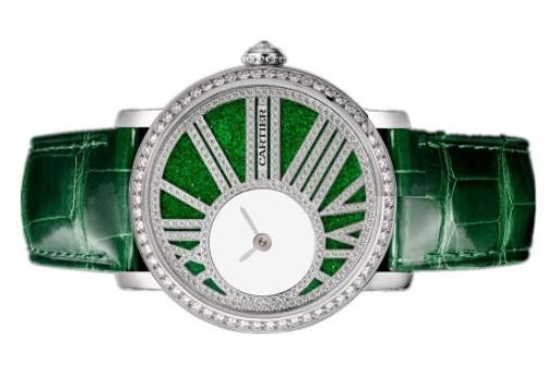 The green dials copy watches are decorated with diamonds.