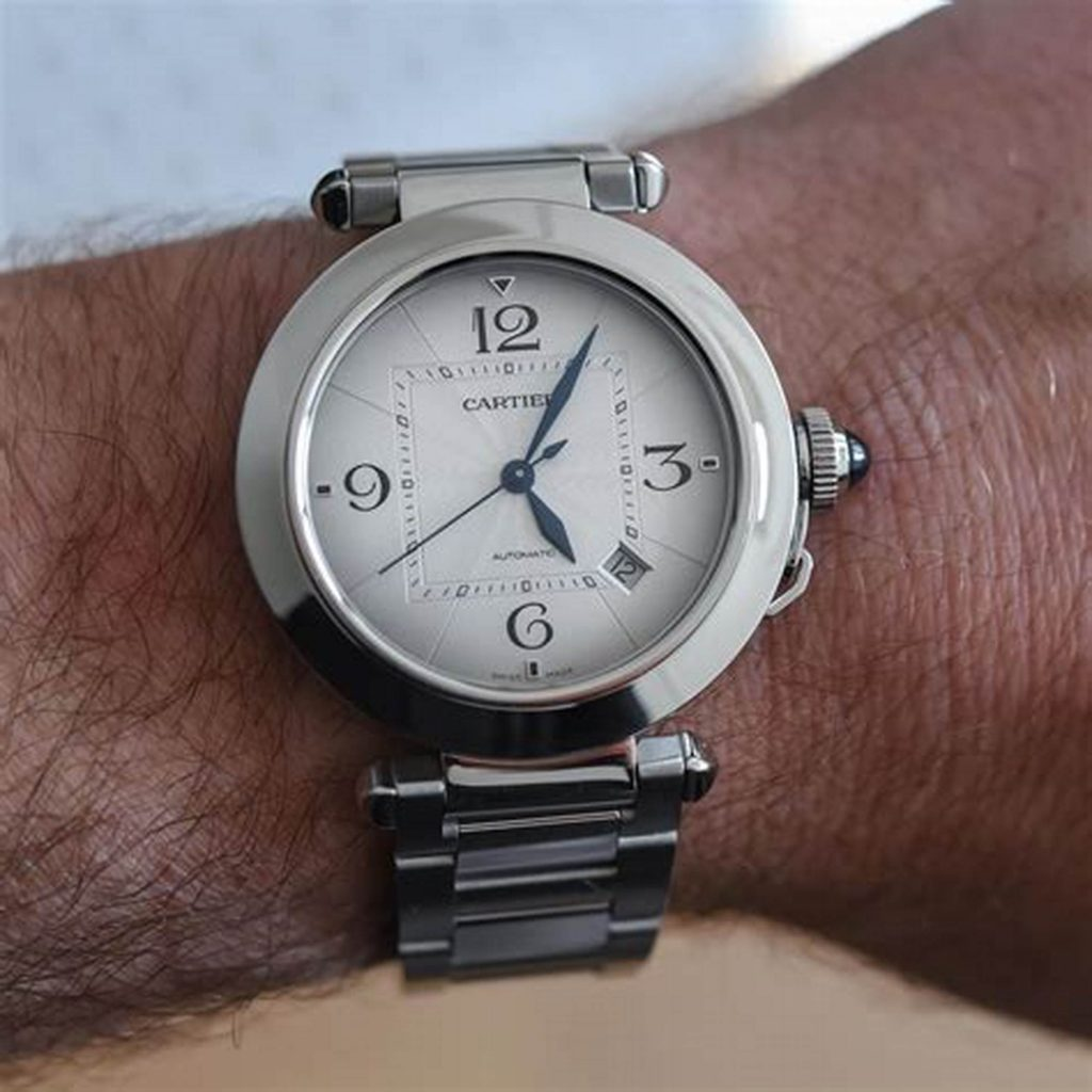 The blue hands are contrasted to the silver dial of fake Cartier.