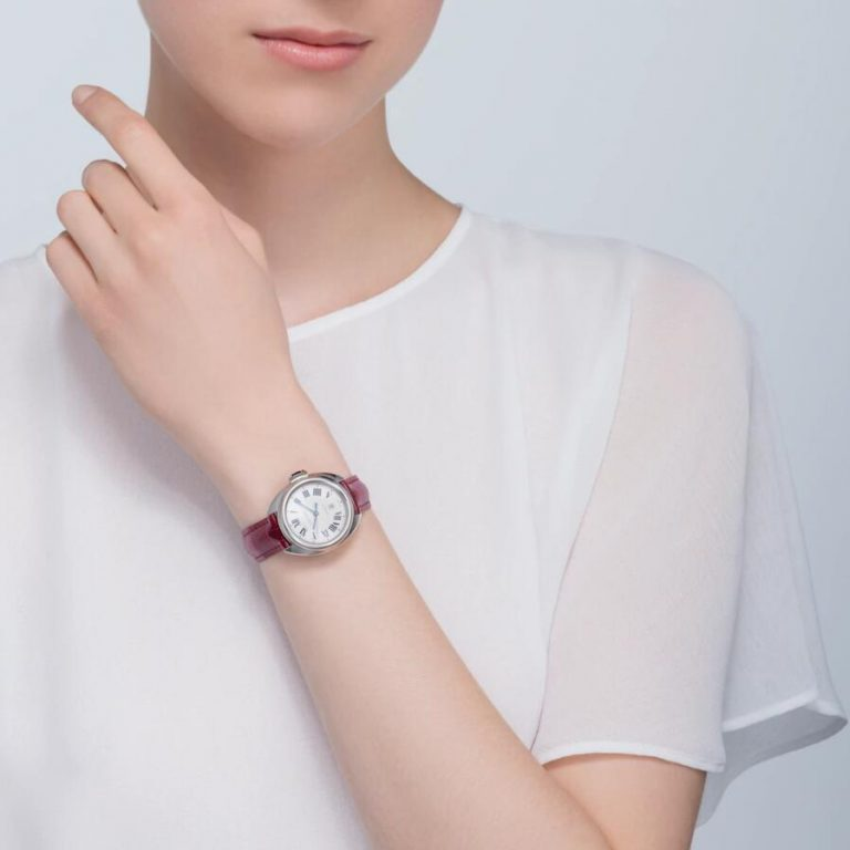 The 35mm replica watch has a silvery dial.