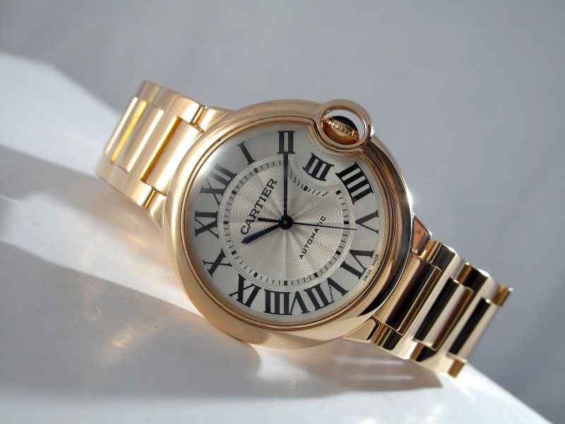 The blue hands and Roman numerals hour markers are contrasted to the silver dial of fake Cartier.