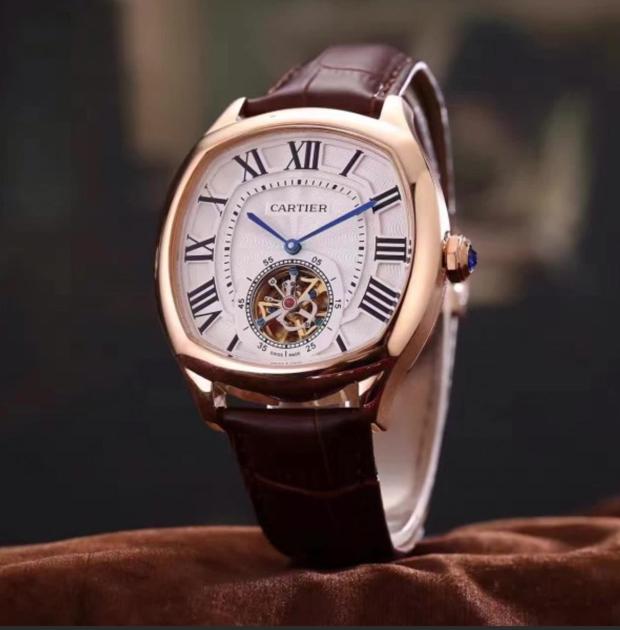 The 18k rose gold fake watch has a silvery dial.