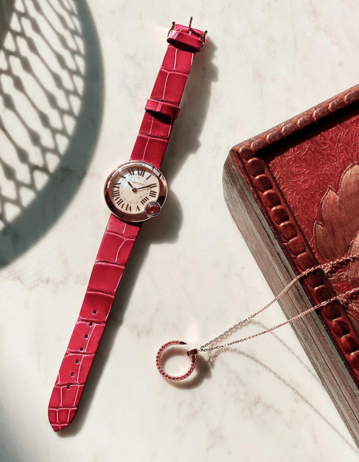 The 18k rose gold fake watch has a red strap.
