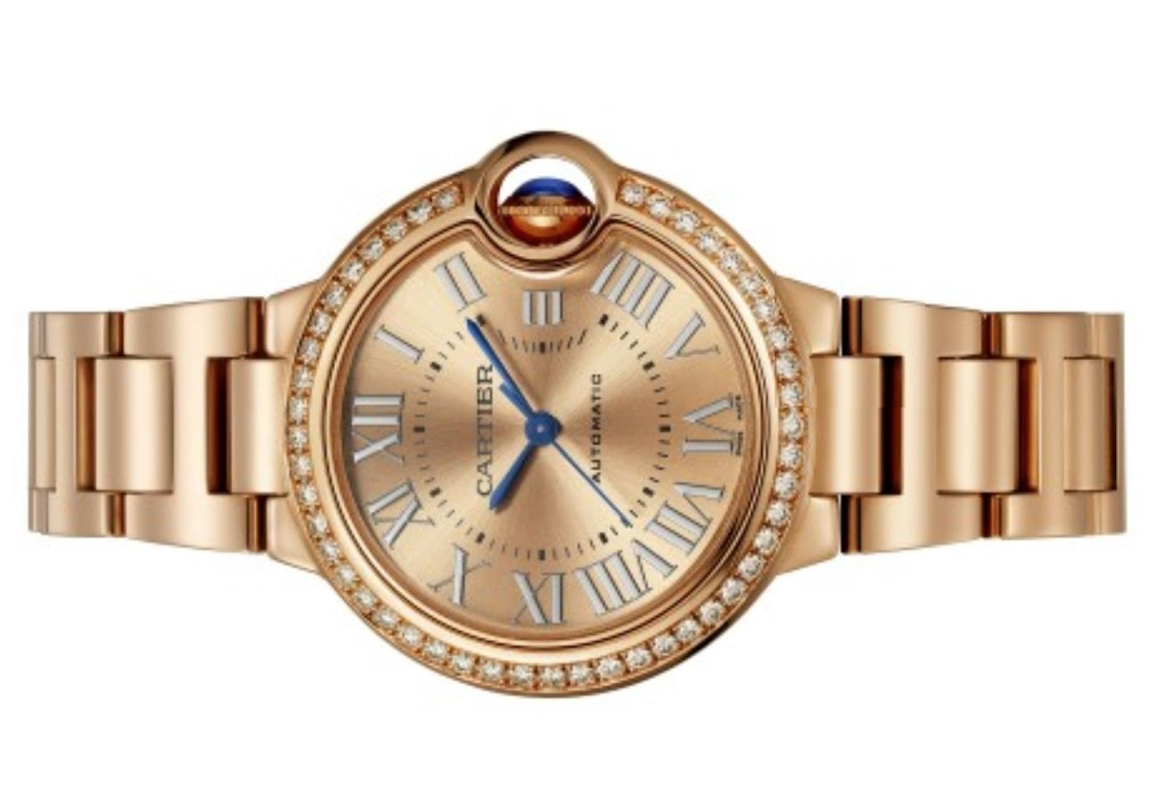 The 33mm fake watch is made from polished 18k rose gold.